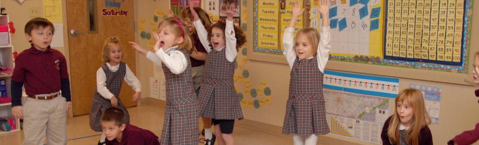 Kindergarten students doing phonics jingles