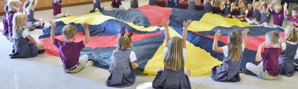 students in music class playing parachute games