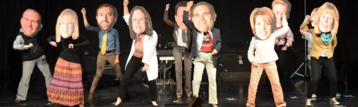 school talent show with teacher cutouts
